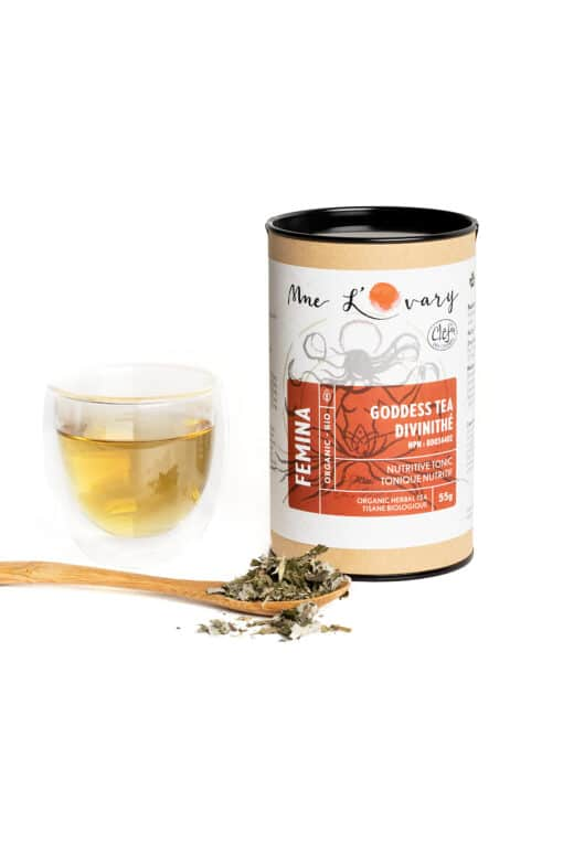 herbal tea leaf and infusion in a cup with spoon for menstrual health